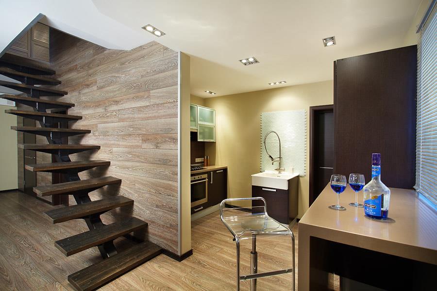 Еще одно удачное исполнение зонирования комнаты с участием ламината