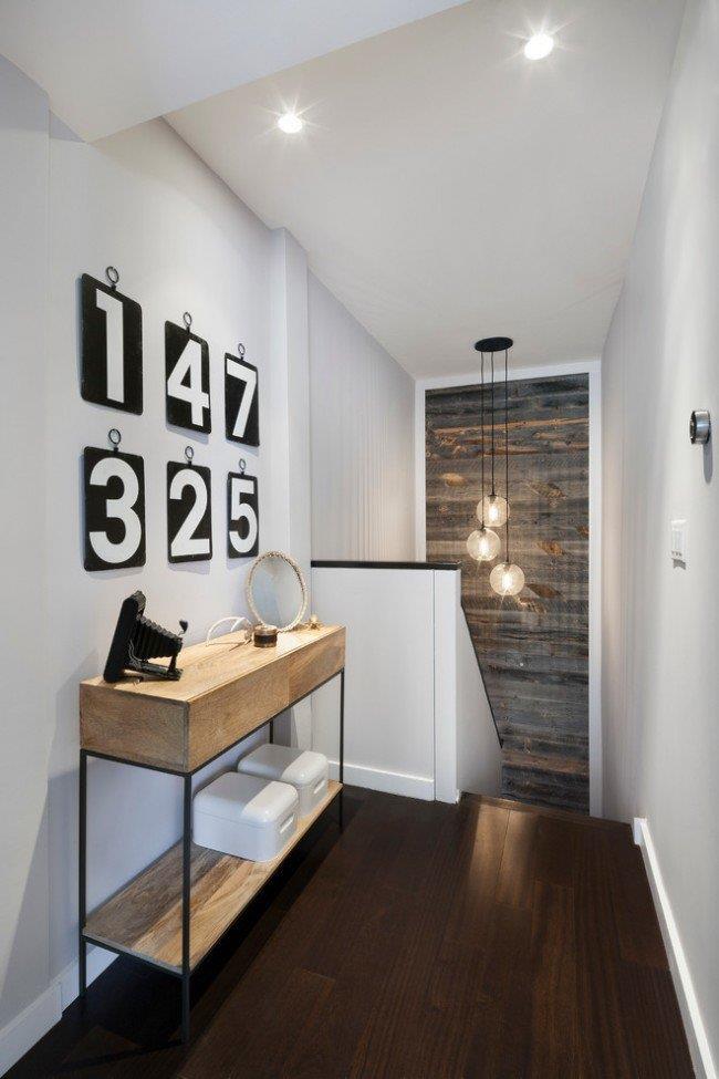Даже небольшой участок стены обшитый ламинатом придаст интерьеру некую особенность