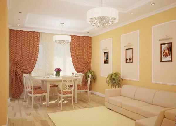 Ламинат молочного оттенка в персиковой гостиной