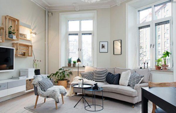 Белый матовый ламинат в интерьере гостиной в скандинавском стиле