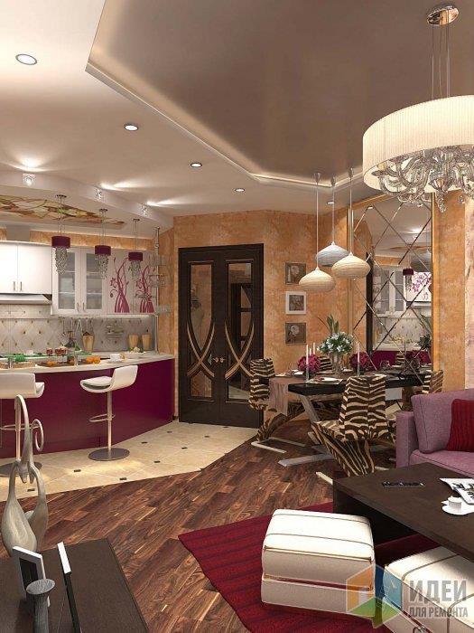 В очередной раз зона кухни и гостиной разделена и материалом и цветом