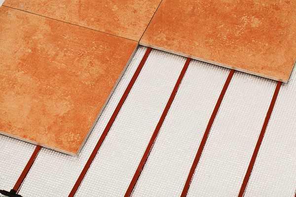 Лучший электрический теплый пол под плитку - карбоновый стержневой мат