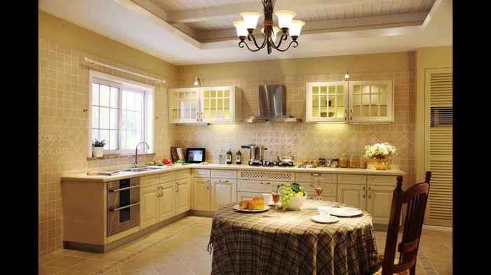 Дизайн квартиры с нишей и белые духовые шкафы в интерьере
