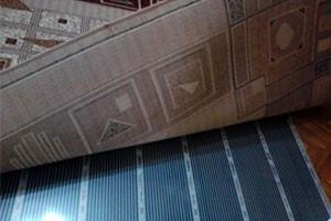 Пленочный теплый пол под ковровым покрытием