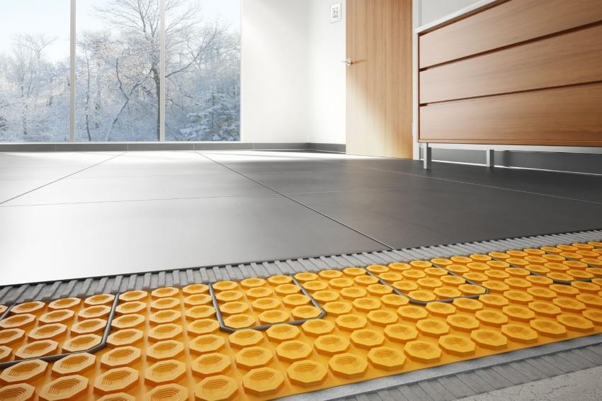Специальные маты для системы теплого пола исполняют роль теплоизолятора, который компенсирует более низкую температуру плитки