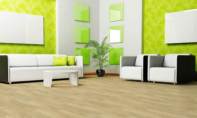 Светлый ламинат в гостинной с ярко-зелеными стенами